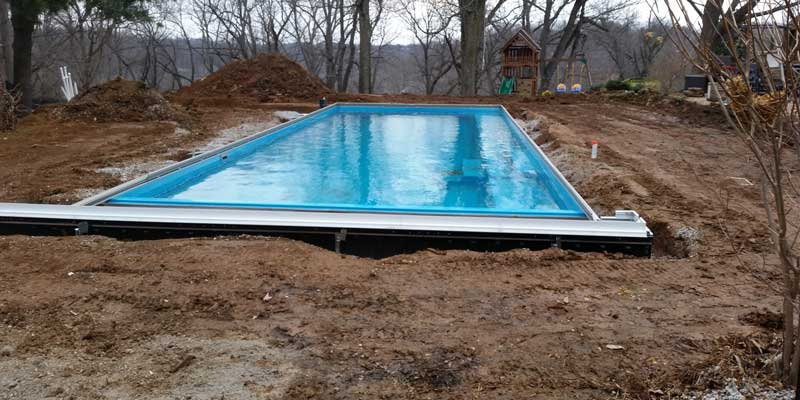 Backfill with sand and fill the pool with water